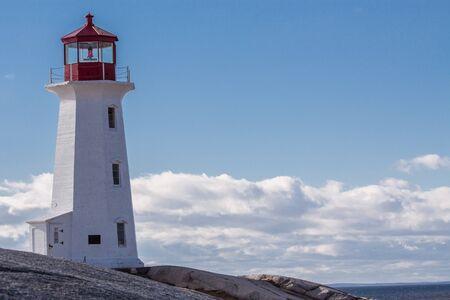 cove: Lighthouse on the cliff, Peggys Cove,Nova Scotia Stock Photo