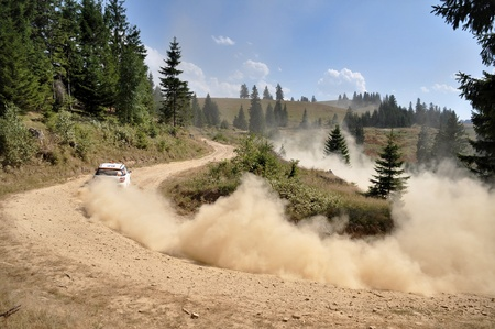 SIBIU, ROMANIA - JULY 20 2012: Sebastian BarbuMarc Banca in their Citroen DS3 at IRC Sibiu Rally 2012
