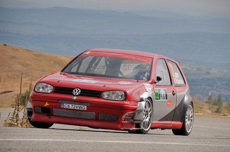 hillclimb: RANCA, ROMANIA - AUGUST 10 2012: Mircea Padurean driving a Volkswagen Golf at Ranca in 2012