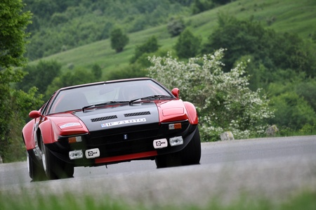hillclimb: TELIU, ROMANIA - MAY 19 2012: Popescu Horia with a beautiful DeTomaso Pantera at Trophy Teliu 2012 hillclimb Editorial