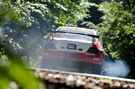 hillclimb: RASNOV, ROMANIA - JUNE 16 2012: Paul Andronic with a 800HP Mitsubishi EVO at Rasnov hillclimb race