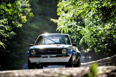 hillclimb: RASNOV, ROMANIA - JUNE 16 2012: Horatiu Ionescu Cristea with a Ford Escort at Rasnov hillcimb in 2012