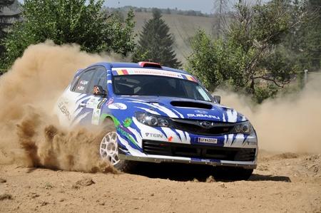 irc: SIBIU, ROMANIA - JULY 20 2012: Aigner AndreeasMinor Ilka - Subaru Impreza WRX STi - IRC Rally Sibiu 2012