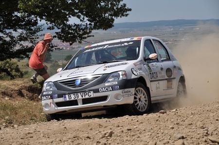 irc: SIBIU, ROMANIA - JULY 20 2012: Radu-Arhire MadalinFus Patrick Robert - Dacia Logan - IRC Rally Sibiu 2012