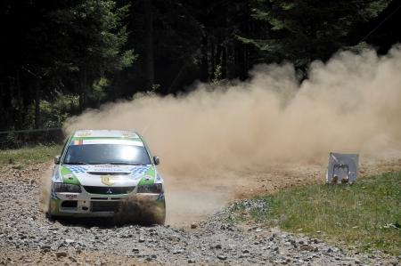irc: SIBIU, ROMANIA - JULY 20 2012: Marisca BogdanItu Sebastian - Mitsubishi Lancer Evo 9 - IRC Rally Sibiu 2012
