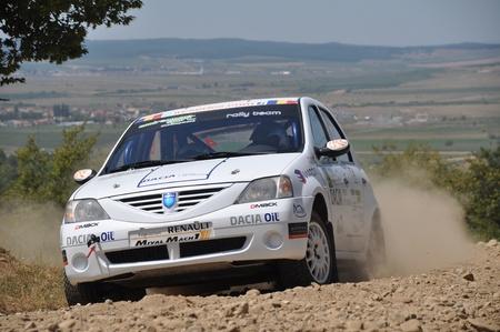 irc: SIBIU, ROMANIA - JULY 20 2012: Barbu BogdanVraja Doru - Dacia Logan - IRC Rally Sibiu 2012