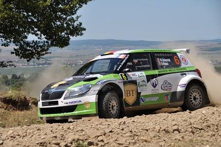 irc: Sibiu, Romania - July 20 2012: Marco TempestiniDorin Pulpea with their Skoda Fabia S2000 at the IRC Sibiu Rally in 2012
