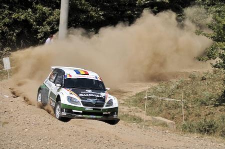 irc: SIBIU, ROMANIA - JULY 20 2012: Girtofan DanBerghea Adrian - Skoda Fabia S2000 - IRC Rally Sibiu 2012 Editorial