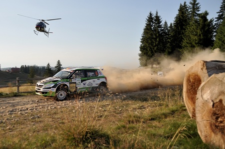 irc: Sibiu, Romania - July 20 2012: Marco TempestiniDorin Pulpea with their Skoda Fabia S2000 at the IRC Sibiu Rally in 2012