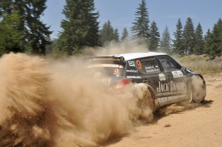 irc: SIBIU, ROMANIA - JULY 20 2012: Szabo GergoBorbely Karoly driving the Skoda Fabia S2000 at IRC Sibiu Rally 2012
