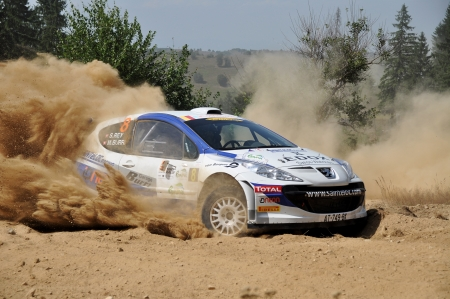 irc: SIBIU, ROMANIA - JULY 20 2012: Mikael BurriRey Stephane - Peugeot 207 S2000 - IRC Rally Sibiu 2012