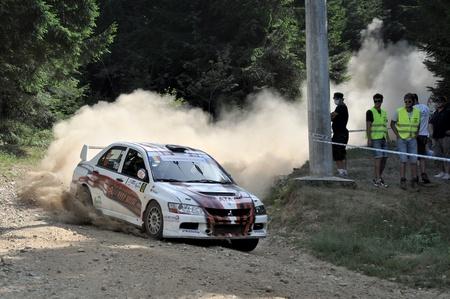 irc: SIBIU, ROMANIA - JULY 20 2012: Titi Aur - Mitsubishi EVO IX - IRC Rally Sibiu 2012
