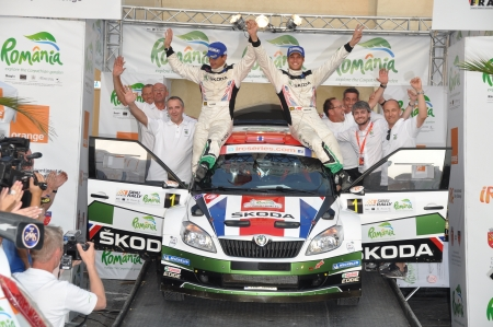 irc: SIBIU, ROMANIA - JULY 20 2012: Skoda UK celebrating victory at IRC Sibiu rally 2012 Editorial