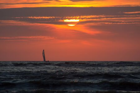 Silhouette of a sailboat at Sunset Time.