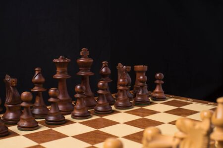 Close View to the Pieces an a Chessboard.