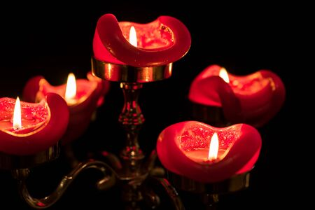 Close-up of five pillar candles on top of a candelabra.. Selective Focus.