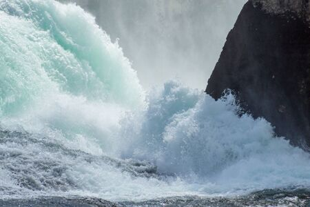 The roaring waters of the Rhine Falls between the rocks from above. Banque d'images