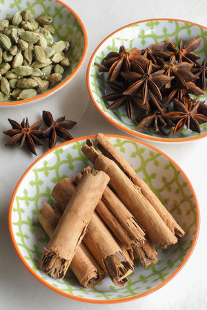 cinnamon bark: Assorted Spices in Bowls Stock Photo