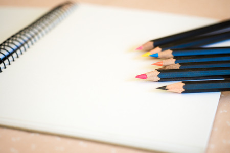 spiral binding: Sketch Pad with Colored Pencils Stock Photo