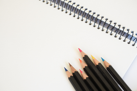 colored pencils: Sketch Pad and Colored Pencils Stock Photo