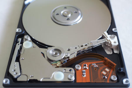 hard disk drive: Hard Disk Drive. The inside of a hard disk drive, showing the readwrite head circuitry and platters, in closeup. Stock Photo