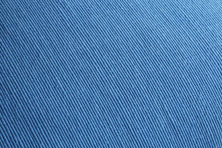 distinct: A piece of bright blue material with a distinct woven texture, in closeup.