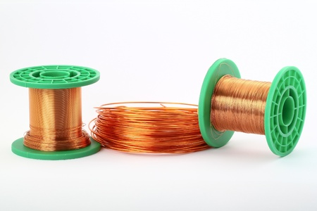 Copper wire on rolls on white Stock Photo