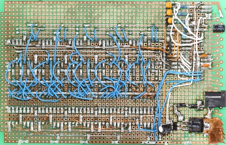 Home made circuit board, lots of wires and connections photo