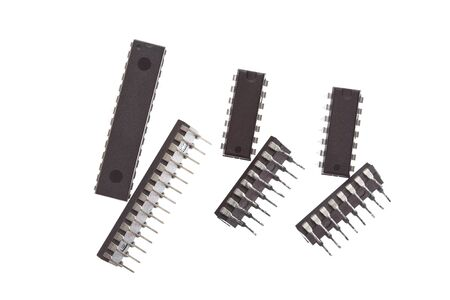 Microchips from the side and the top. Three ( DIP ) chips of a different size.