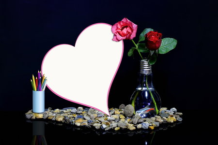 Roses In A Vase With Fish And A Heart Shaped Notebook Stock Photo