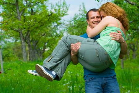Young couple having fun in nature photo