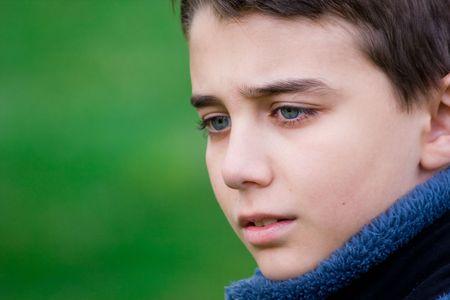 child stress: Closeup portrait of a sad teenager