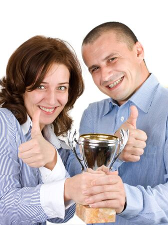 Successful businessteam holding a trophy Stock Photo - 4167132