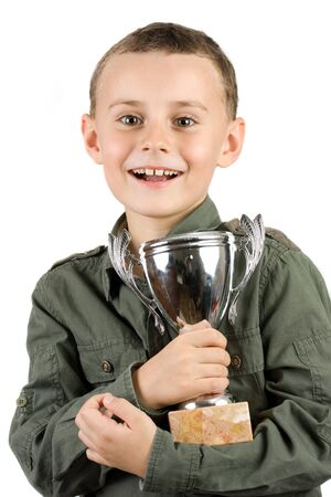 smiling champion with his trophy, isolated on white photo