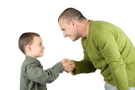 shake hands: father and son shaking hands