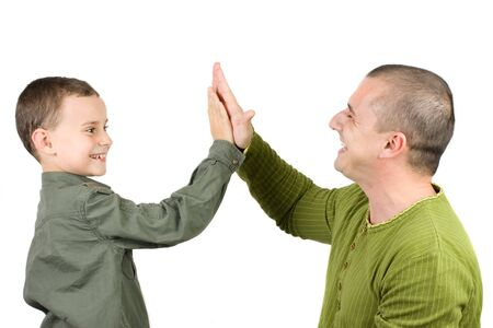 family of five: Father and son doing a high five