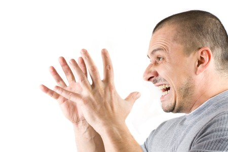 madman: man screaming isolated on white