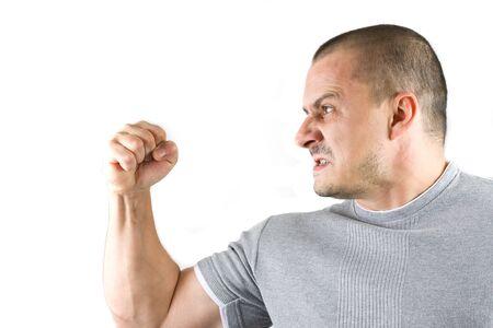 aggressive man showing his fist photo
