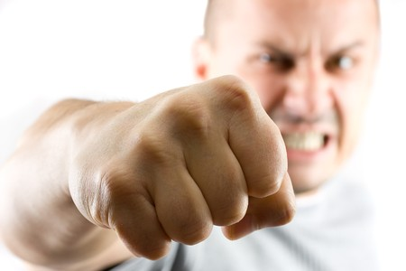 madman: aggressive man showing his fist isolated on white Stock Photo