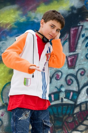 Teenager listening music against a graffiti wall Stock Photo - 4181678