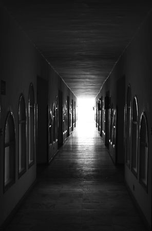 deadlock: Black tunnel passage from the doors direct to the light Stock Photo