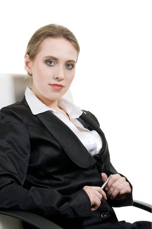 kindly: Young business woman with pen kindly smiling, sitting on the chair Stock Photo