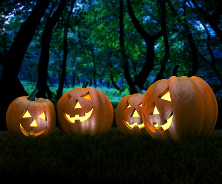 glowing carved: A spooky scary blue Halloween background scene with forest and pumpkins.