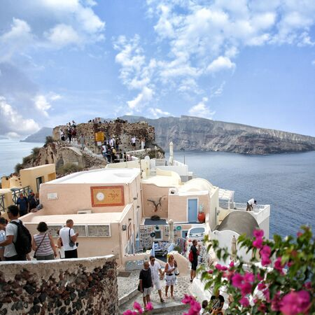 cycladic: Santorini island, Greece. Oia, Fira town. Traditional and famous houses and churches over the Caldera, Aegean sea