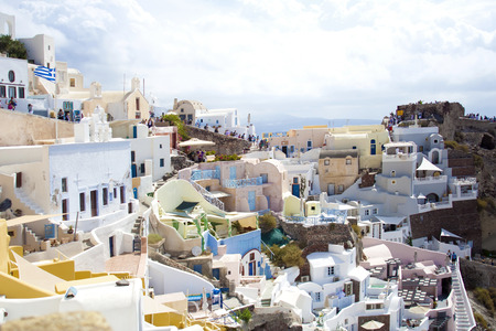sea of houses: Santorini island, Greece. Oia, Fira town. Traditional and famous houses and churches over the Caldera, Aegean sea