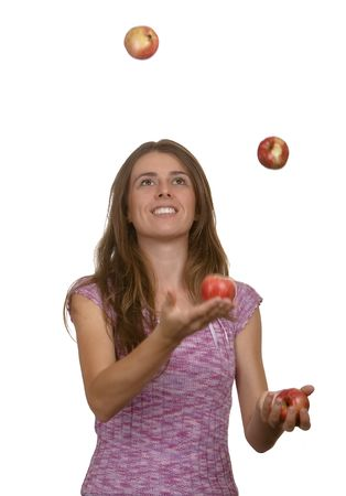 The young girl juggles with apples photo