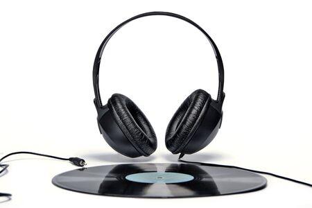 Headphones and old vinyl record Stock Photo