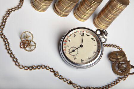 Pocket watch, coins, clockwork details