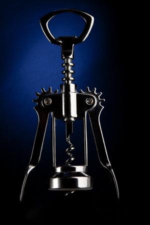 Corkscrew silhouette on a dark blue background Stock Photo