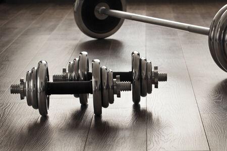 dumbells for fitness on wooden floor